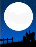 Agriculture progress. Tractor working under full moon Stock Photo