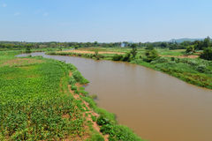 Agriculture river  fields. River between agriculture fields Mountain background Stock Photos