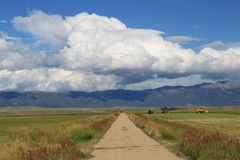 Agriculture in shadow of Rocky Mountains. Royalty Free Stock Photo
