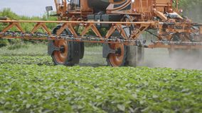 Agriculture spraying pesticides. Farming agriculture. Fertilizer spreader. Farming equipment for field irrigation. Agricultural machinery. Agriculture spraying stock footage