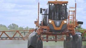 Agriculture spraying pesticides. Fertilizer spreader spraying field stock video