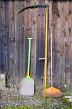 Agriculture tools and old wooden farm wall Royalty Free Stock Photography
