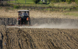 Agriculture - tractor. The Tractor - modern farm equipment in field stock photos