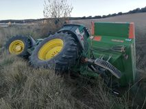 Tractor rolled over in the harvest Royalty Free Stock Images