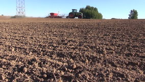 Agriculture tractor on farm field seeding  grains stock video footage