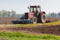 Agriculture - Tractor on the field Stock Photos