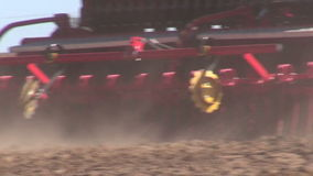 Agriculture tractor on   field seeding  grains stock video footage