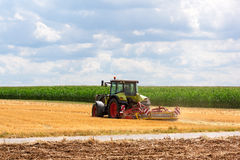 Agriculture - tractor ploughing at the field Stock Photo