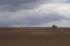Agriculture.The tractor prepares the field for sowing wheat in Stock Photography