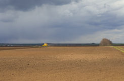 Agriculture.The tractor prepares the field for sowing wheat in Royalty Free Stock Photography