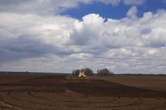 Agriculture.The tractor prepares the field for sowing wheat in Royalty Free Stock Images