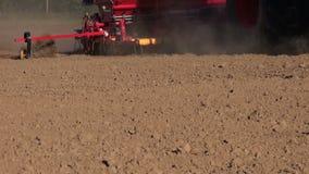 Agriculture tractor seeding crop grain on farm field soil stock footage