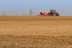 Agriculture tractor sowing seeds Royalty Free Stock Photo