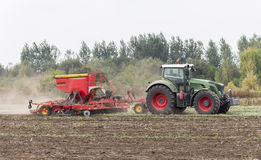Agriculture tractor sowing seeds Royalty Free Stock Image