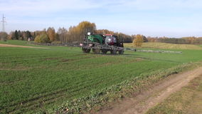 Agriculture tractor spraying crop field stock footage