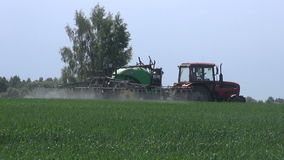 Agriculture tractor spraying  crop wheat field stock video footage