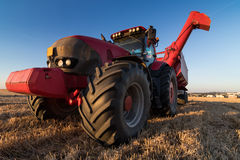 Agriculture tractor at stubble field Stock Photography