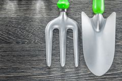 Agriculture trowel fork hand spade on wooden board Royalty Free Stock Images