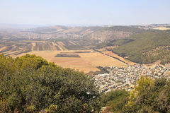 Agriculture valley with fields and arab village, Israel. Stock Image