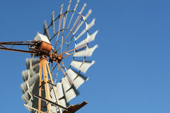 Agriculture windmill. An agriculture windmill against a blue sky royalty free stock image