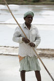 Agriculturist is harvesting salt farm, Pondicherry area Royalty Free Stock Photos