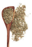 Agrimony Herb. Used in herbal medicine in a wooden spoon over white background Stock Photos