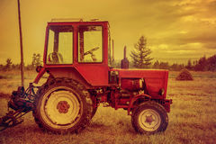 Agrimotor in the field with hay Stock Photo
