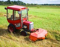 Agrimotor on meadow Stock Images