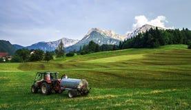 Agrimotor na polu w Austria Zdjęcie Stock