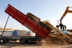 Agrippeur et camion Photo stock