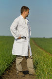 Agronomist in onion field Stock Photography