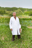 Agronomist in vegetable garden Stock Photography