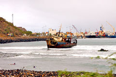 Aground boat. An aground boat in the Praia bay the capital city of the archipelago of Cape Verde royalty free stock photo
