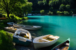 Aground boats on the bank of river Soča Stock Photo
