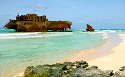 Aground cargo boat. The Cabo Santa Maria wreck is aground on a beach Boa esperanca in the island of Boa Vista in the archipelago of Cape Verde since 1968 stock images