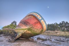 Aground at low tide. Abandoned ship on a beach in the light of the moon Royalty Free Stock Images