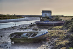 Aground. Small boats used for years by maricadores in salt marshes and mudflats Royalty Free Stock Photos