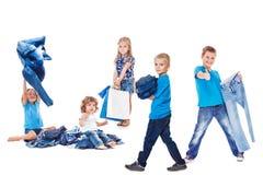 Agrupe com roupa das calças de brim Imagens de Stock Royalty Free