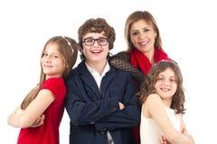 Agrupe el tiro de una familia aislada en blanco Fotografía de archivo libre de regalías