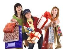 Agrupe a la muchacha de la gente con el bolso de compras y el rectángulo de regalo. Fotos de archivo libres de regalías