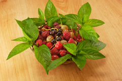 Agrus mint raspberry currant. In a basket Royalty Free Stock Images
