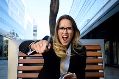 Agry business woman screaming. Stock Photo