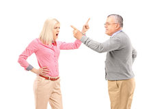 An agry female and mature man arguing Stock Images