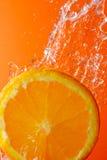 Agua anaranjada y corriente Imágenes de archivo libres de regalías