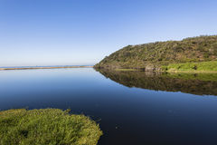 Agua azul del vidrio de la laguna Imagenes de archivo