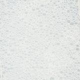 Agua burbujeante del jabón de la espuma Foto de archivo libre de regalías