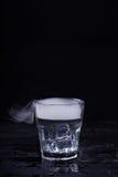 Agua caliente en un vidrio Fotografía de archivo libre de regalías