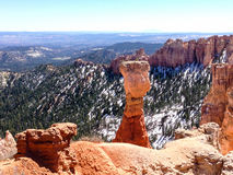 Agua Canyon, Bryce Canyon on sunshine. Scenery of the outstanding hoodoo, red rock formations, among snow in green forest backdrop at Agua Canyon overlook of Royalty Free Stock Photo
