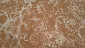 Agua clara de la playa de la arena Foto de archivo libre de regalías