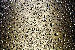Agua de bronce de los drofs Fotos de archivo libres de regalías